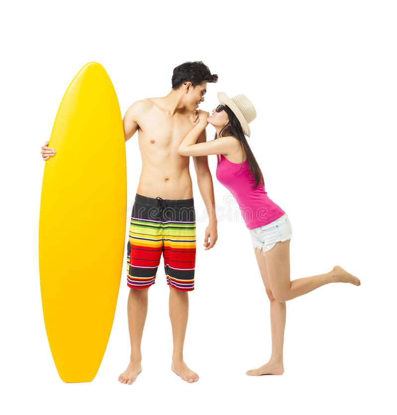 jonge surfer met meisje stock afbeeldingen
