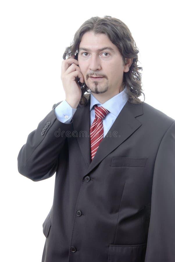 Jonge toevallige mens op de telefoon. stock foto
