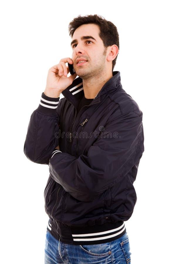 Jonge toevallige mens op de telefoon royalty-vrije stock afbeelding