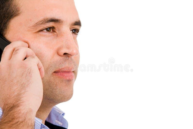 Jonge toevallige mens op de telefoon stock afbeelding