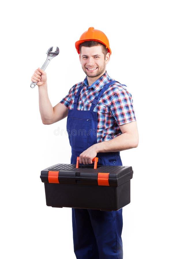 Jonge toolbox en de moersleutel van de herstellerholding stock foto's