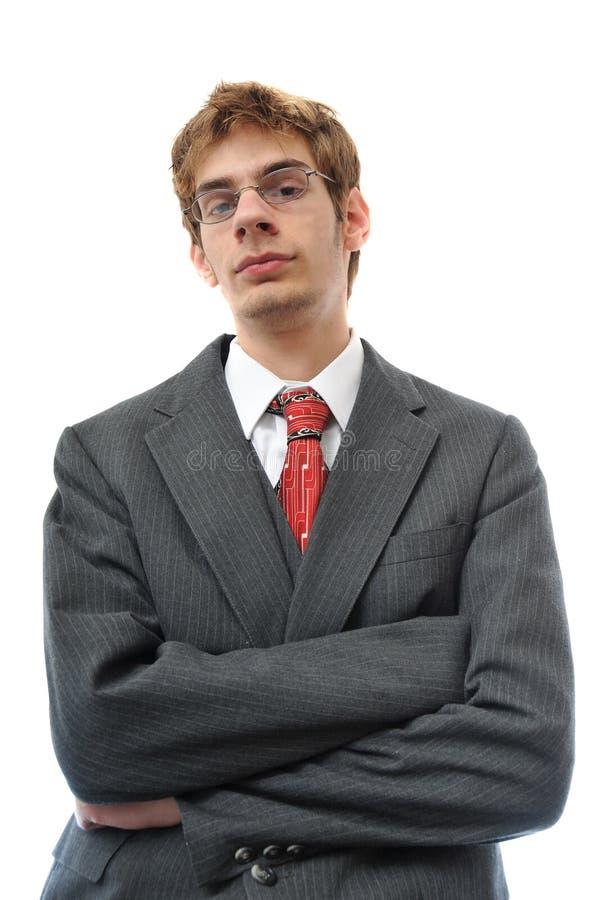Jonge volwassene in kostuum met gekruiste wapens royalty-vrije stock afbeelding