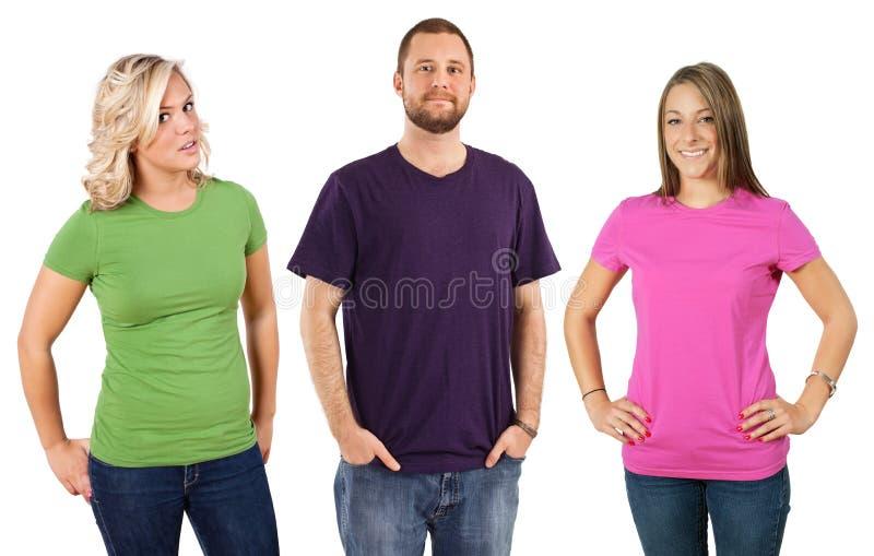 Jonge volwassenen met lege overhemden stock foto