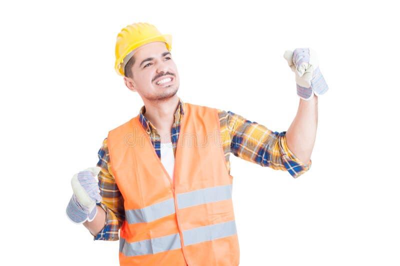 Jonge vrolijke aannemer die een bouwvakker en een ponsen dragen ai stock afbeelding