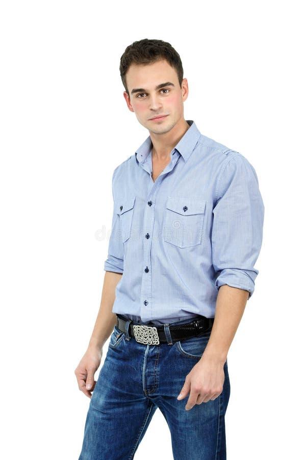 Jonge vrolijke mens in blauw overhemd en jeans, portret van attracti stock afbeelding