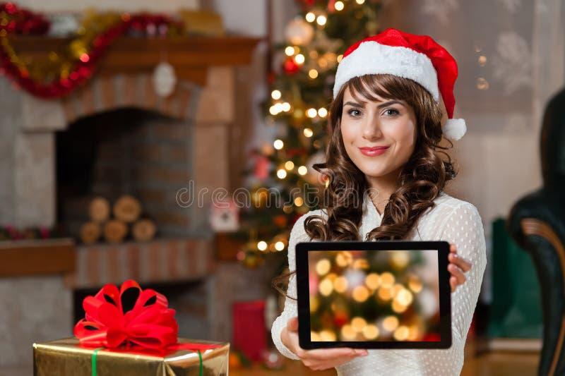 Jonge vrouw bij Kerstmis royalty-vrije stock afbeelding