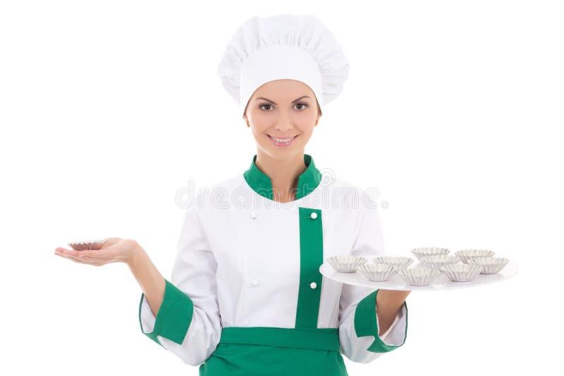 Jonge vrouw in chef-kok eenvormig met geïsoleerde de vormen van de metaalmuffin royalty-vrije stock afbeelding