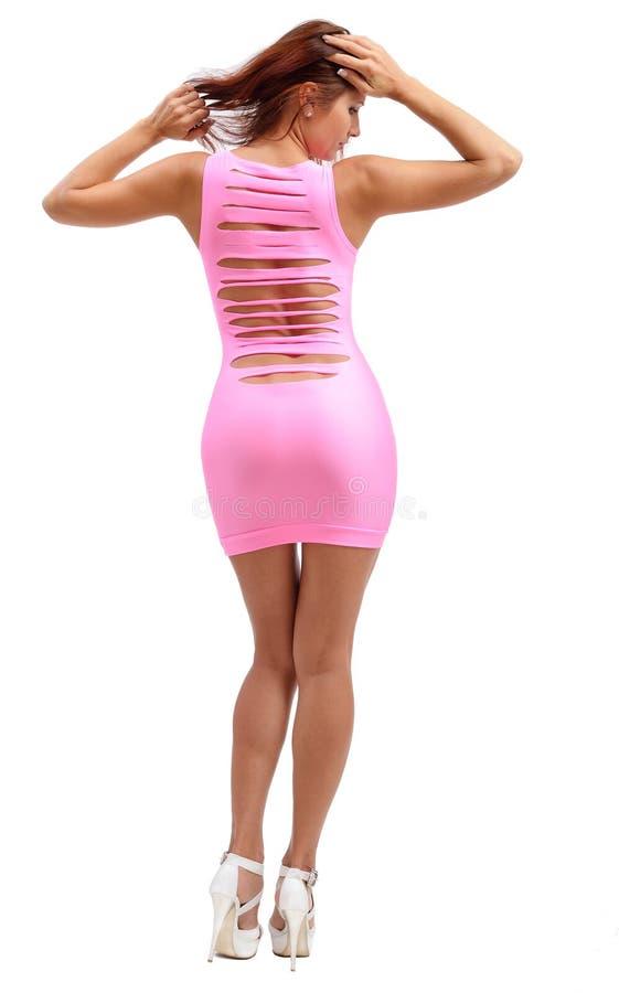 Jonge vrouw in de roze kleding royalty-vrije stock afbeelding