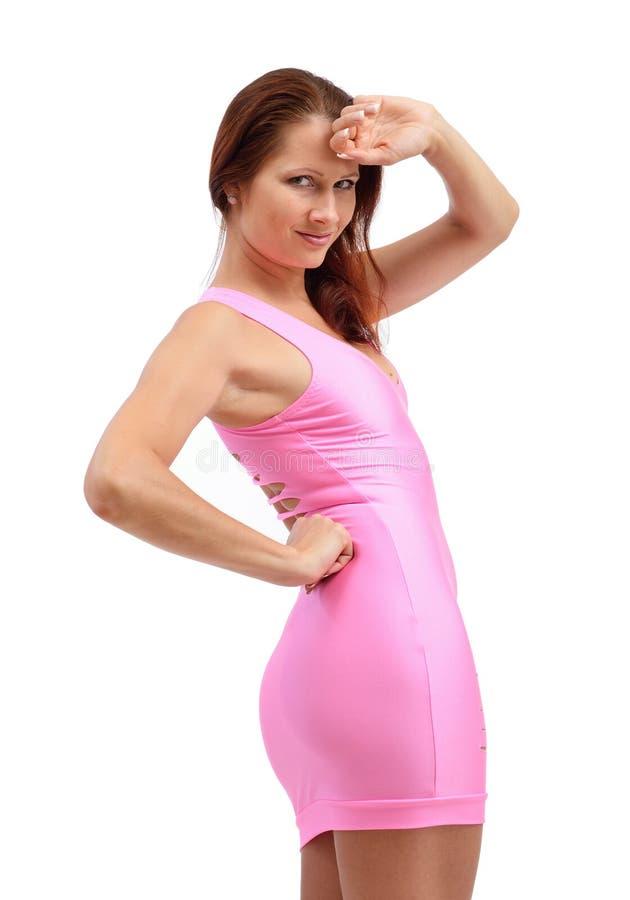 Jonge vrouw in de roze kleding stock afbeeldingen