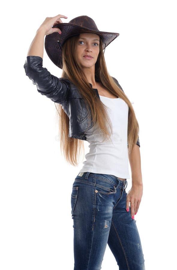 Jonge vrouw die cowboyhoed dragen royalty-vrije stock fotografie
