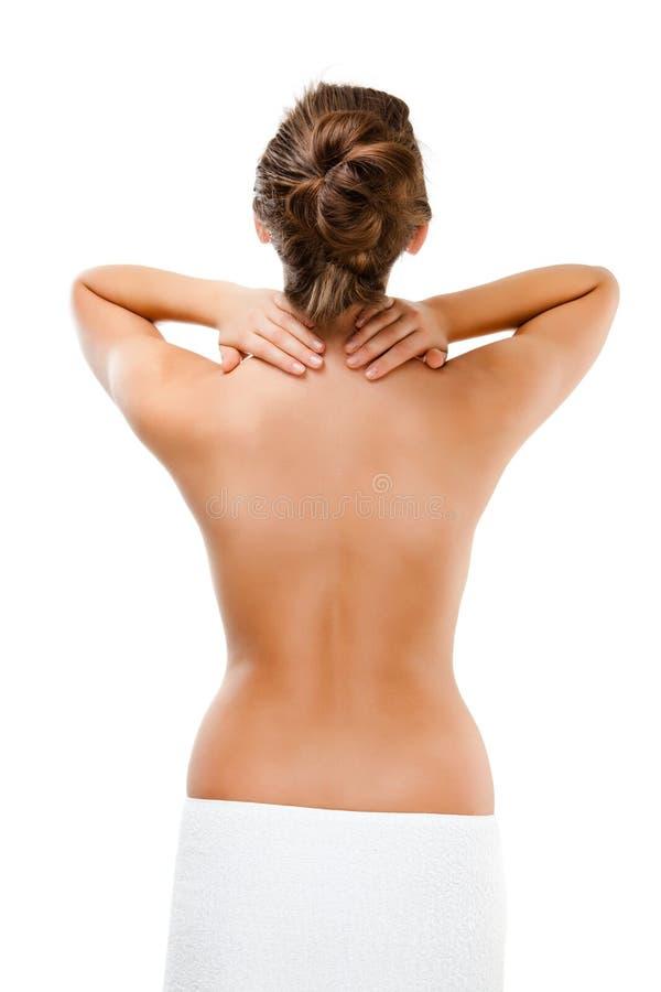 Vrouw die pijnrug masseren stock afbeelding