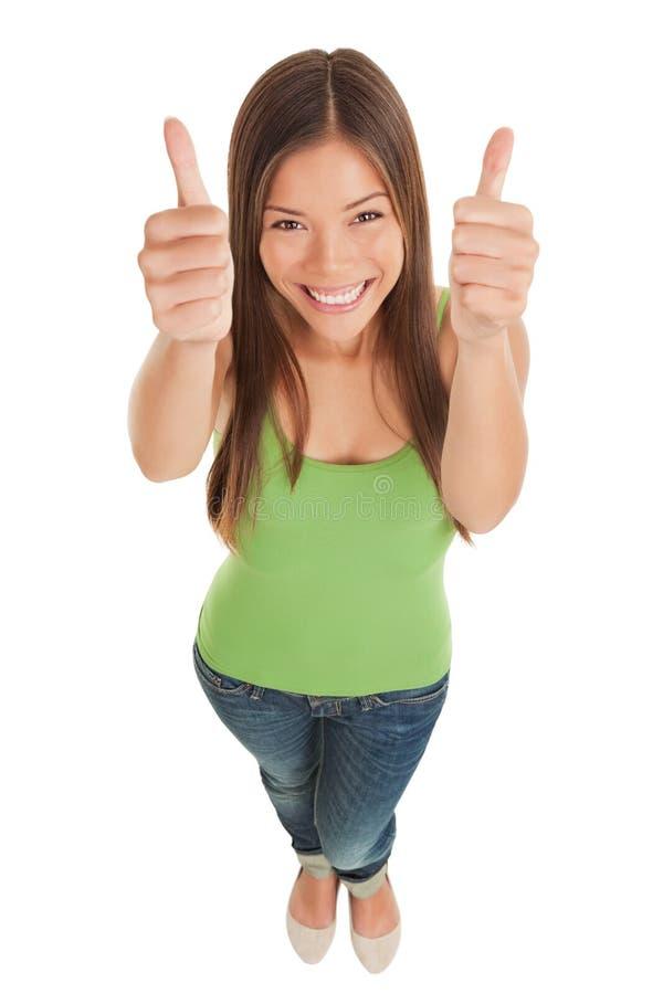 Jonge vrouw die dubbele duimen opgeven royalty-vrije stock foto's