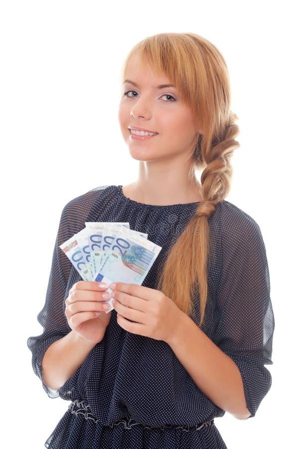 Jonge vrouw die euro contant geld houdt stock fotografie