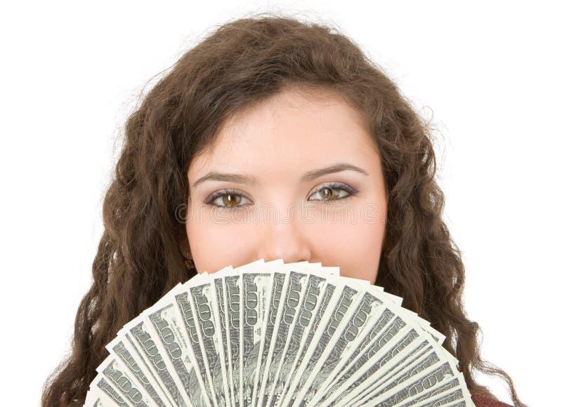 Jonge vrouw die geld toont stock afbeelding