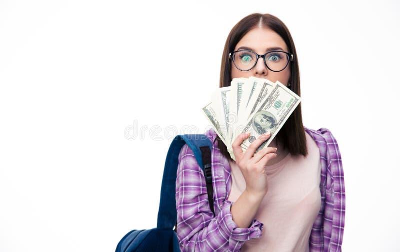 Jonge vrouw die haar mond behandelen met bollen van dollar royalty-vrije stock fotografie
