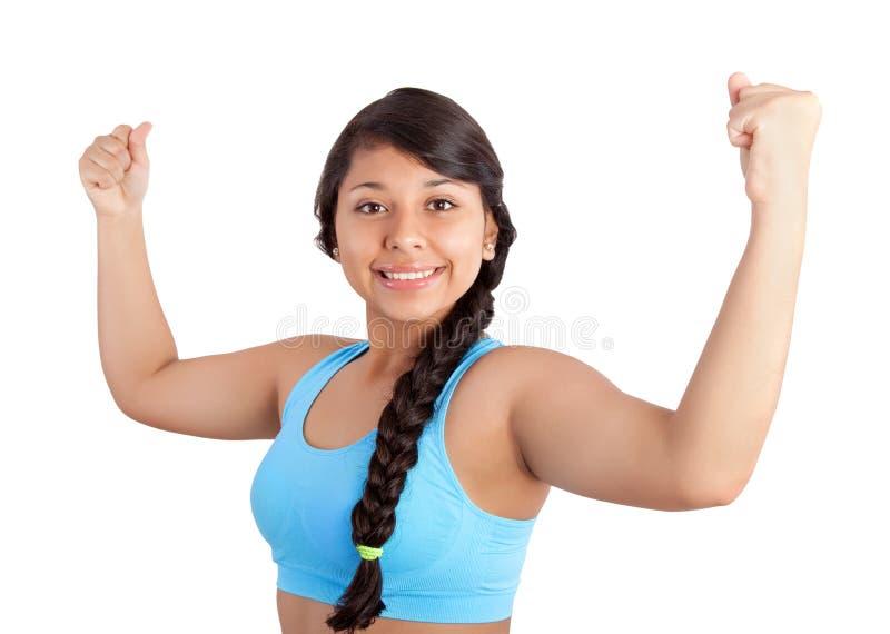 Jonge vrouw die haar spieren toont royalty-vrije stock foto's