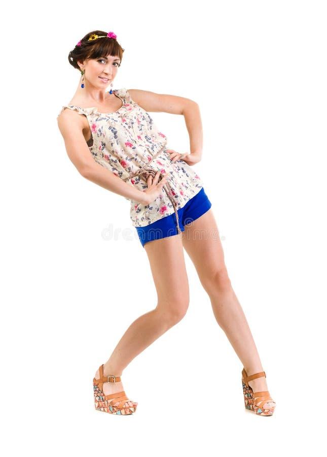 Jonge vrouw die het hete broek stellen dragen stock foto's