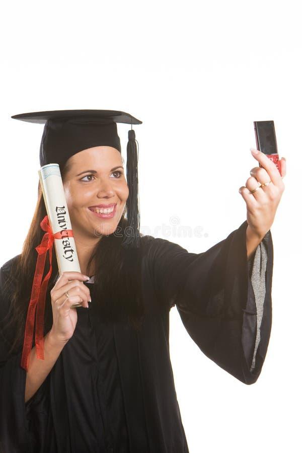 Jonge vrouw die met een Diploma een diploma wordt behaald royalty-vrije stock foto