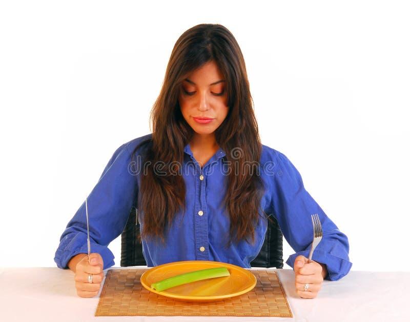 Jonge vrouw die met haar dieet wordt verstoord royalty-vrije stock foto's
