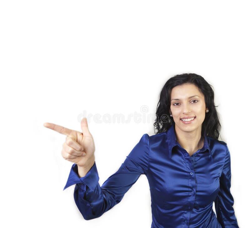 Jonge vrouw die met hand richt stock foto's