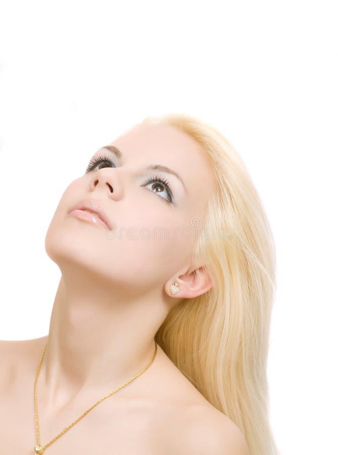 Jonge vrouw die omhoog kijkt royalty-vrije stock foto's