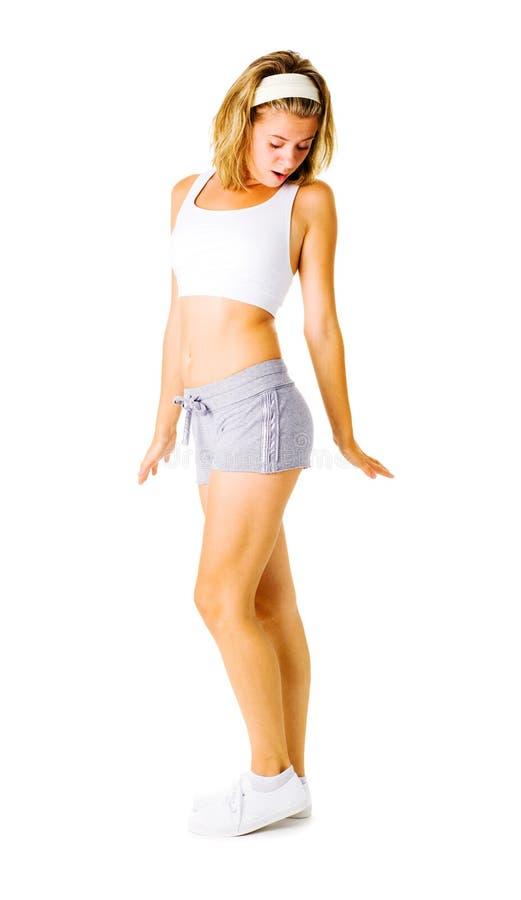 Download Jonge Vrouw Die Op Wit Uitwerkt Stock Foto - Afbeelding bestaande uit pasvorm, gezondheid: 10783448