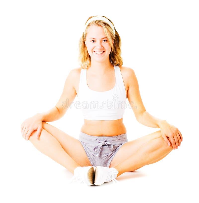 Download Jonge Vrouw Die Op Wit Uitwerkt Stock Afbeelding - Afbeelding bestaande uit levensstijl, persoon: 10783673