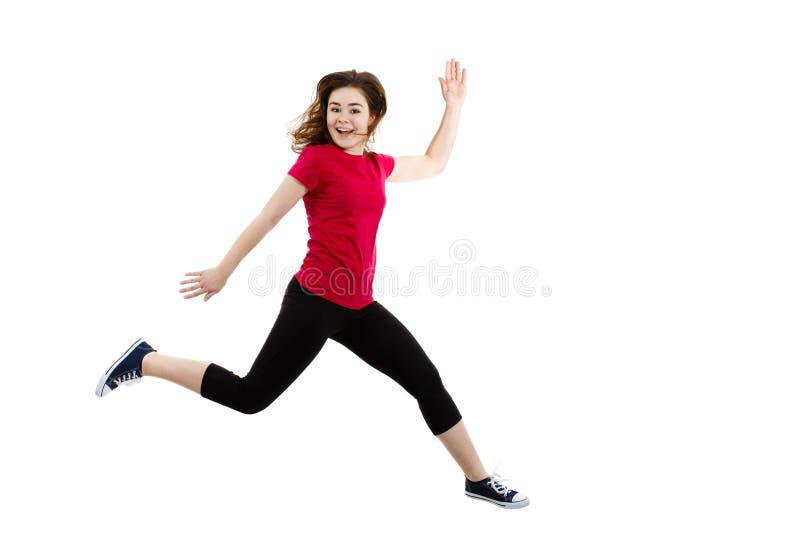 Jonge vrouw die op witte achtergrond springen stock afbeelding