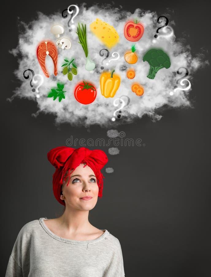 Jonge vrouw die over gezond voedsel denken stock afbeeldingen