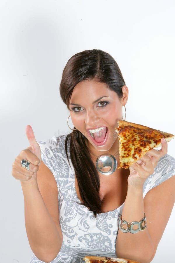 Download Jonge vrouw die pizza eet stock foto. Afbeelding bestaande uit geïsoleerd - 10782260