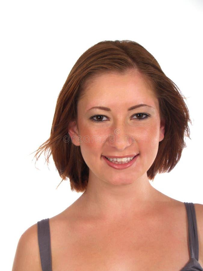 Jonge Vrouw die Rood Haar glimlacht stock afbeelding