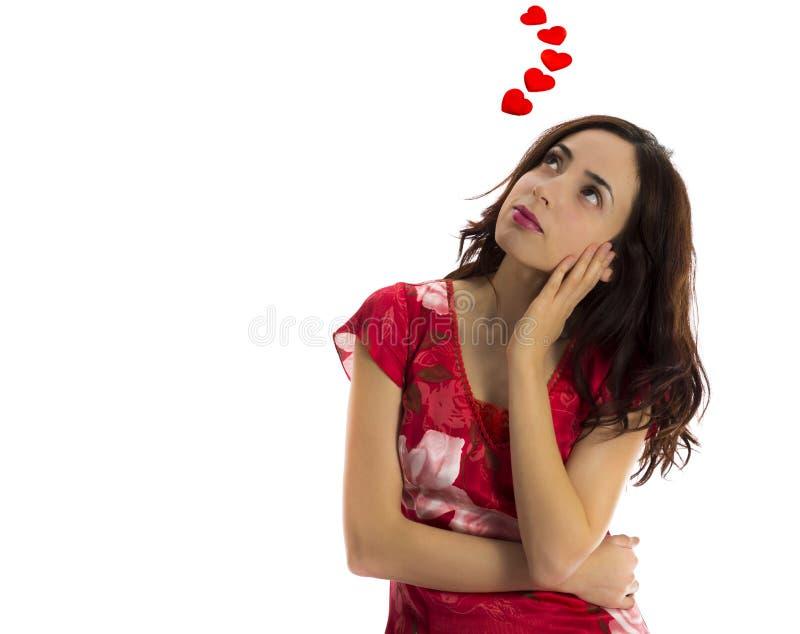 Jonge vrouw die van haar minnaar dromen stock fotografie