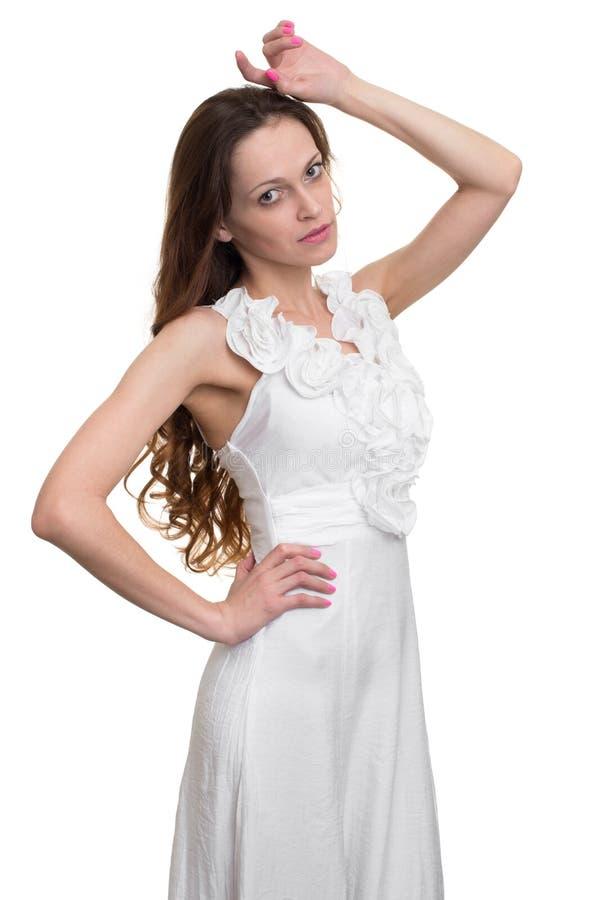 Jonge vrouw die witte kleding draagt royalty-vrije stock fotografie