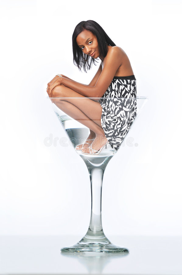 Jonge Vrouw in een martini glas royalty-vrije stock afbeelding