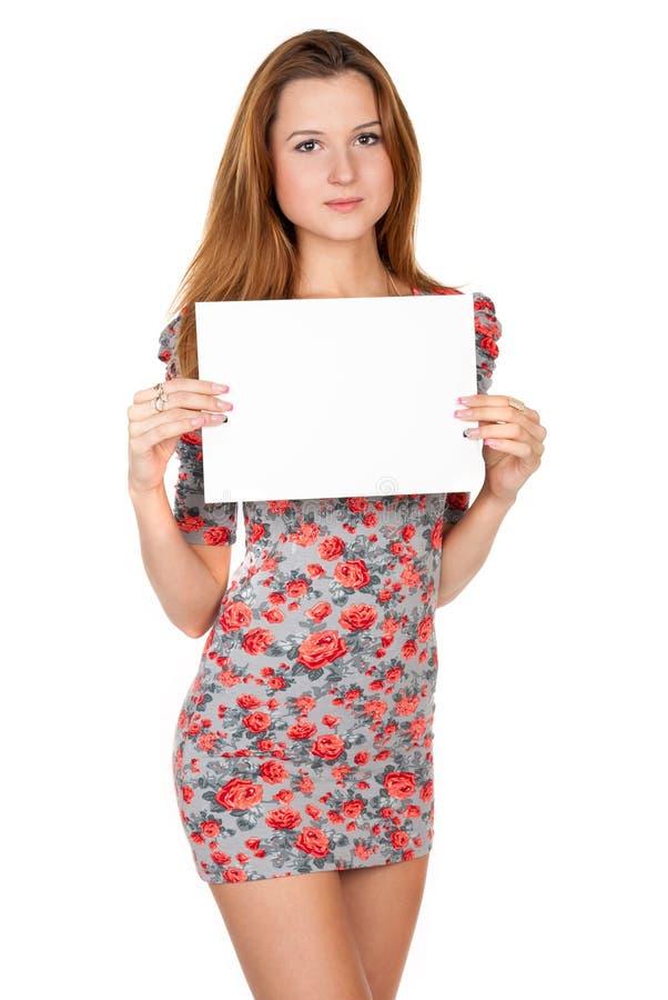 Jonge vrouw en lege witte spatie stock afbeeldingen