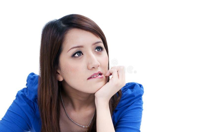 Jonge vrouw het bijten lippen royalty-vrije stock fotografie