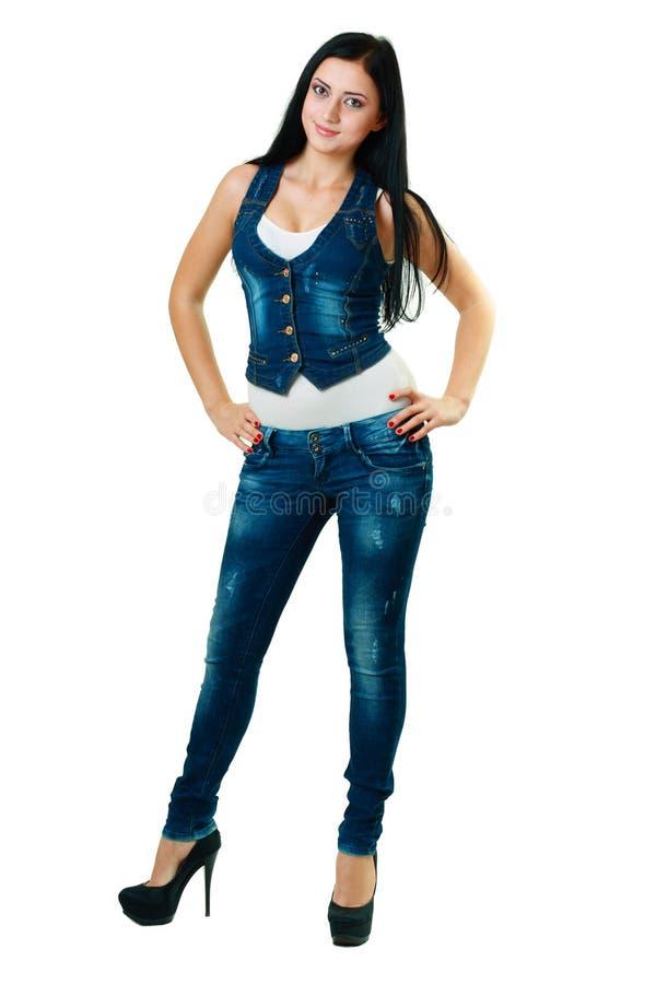 Jonge vrouw in jeans stock fotografie