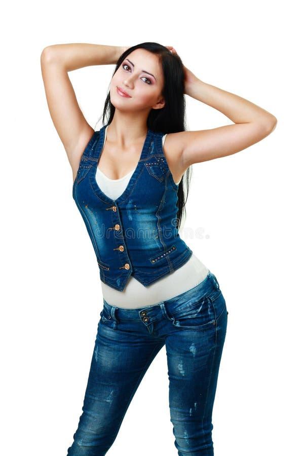 Jonge vrouw in jeans royalty-vrije stock fotografie