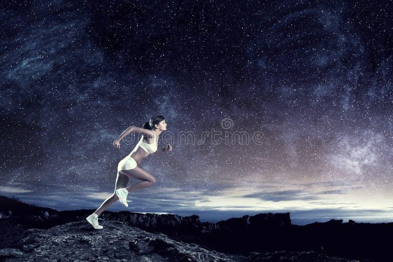 Jonge vrouw jogger Gemengde media royalty-vrije stock foto's