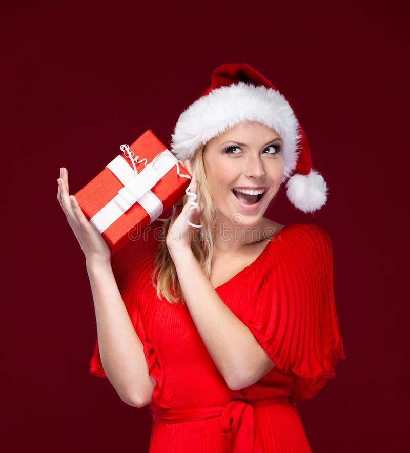 Jonge vrouw in Kerstmis GLB stock foto's