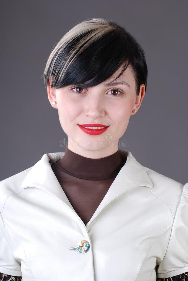 Jonge vrouw in kostuum royalty-vrije stock fotografie