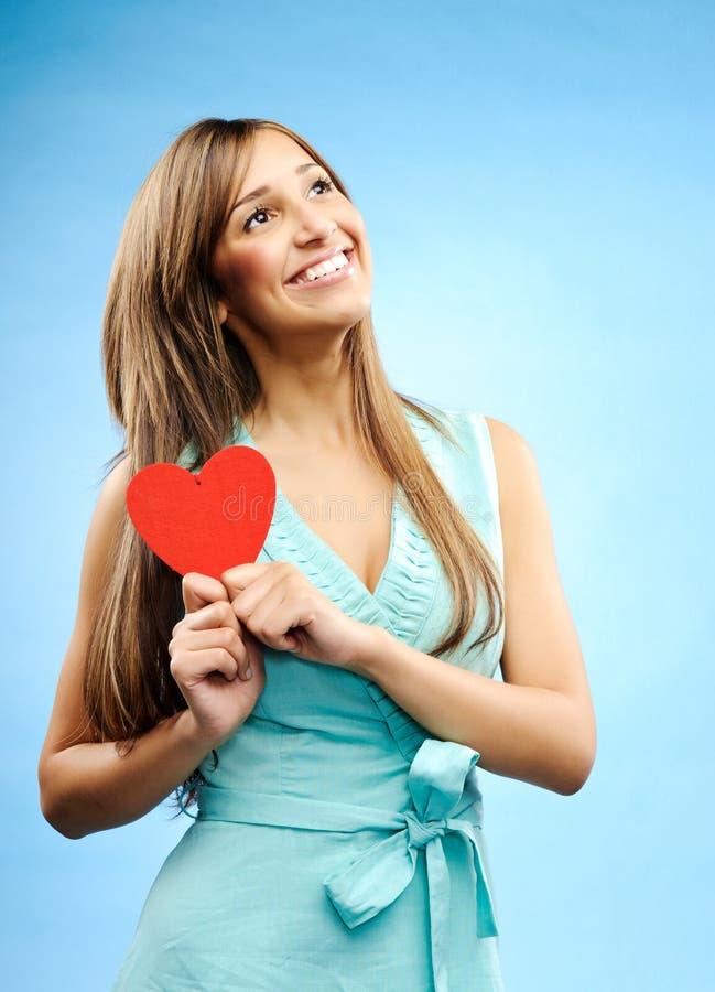 Jonge vrouw in liefde stock foto