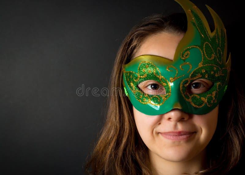 Jonge vrouw in masker royalty-vrije stock afbeelding