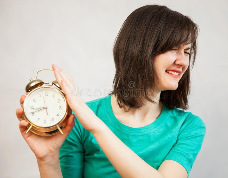 Jonge vrouw met alarm royalty-vrije stock afbeelding