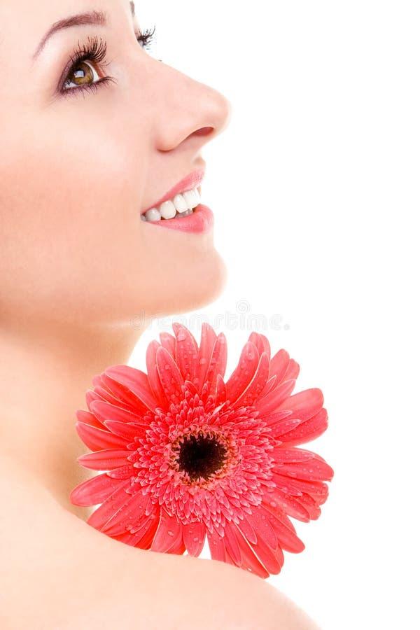 Jonge vrouw met bloem royalty-vrije stock afbeelding