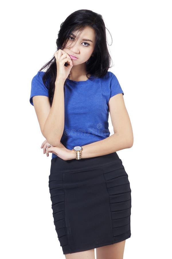 Jonge vrouw met bored uitdrukking stock afbeeldingen