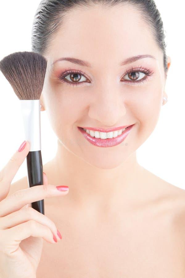 Jonge vrouw met borstel voor make-up royalty-vrije stock foto
