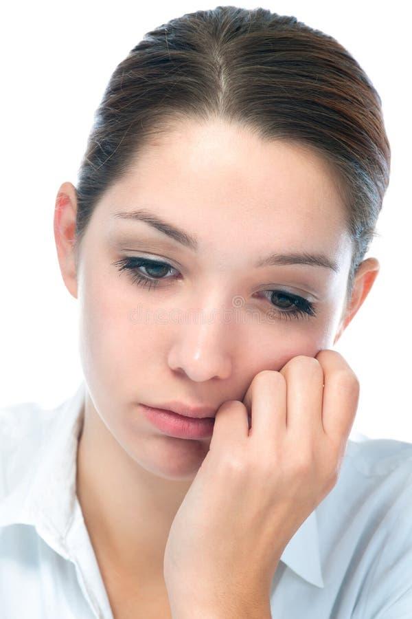 Jonge vrouw met droevige uitdrukking stock foto