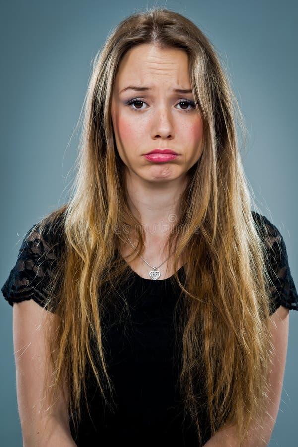 Jonge Vrouw met Droevige Uitdrukking royalty-vrije stock afbeeldingen