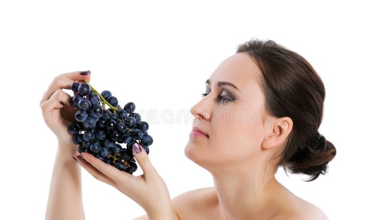 Jonge vrouw met druif royalty-vrije stock afbeelding